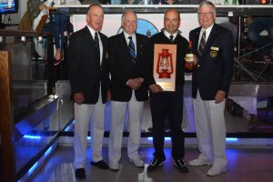 Ret'd Lieutenant Commander Jeff Kibble (holding rum) gladly accepts the Lanterne Rouge Award
