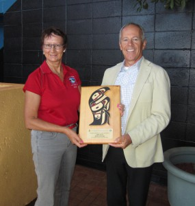CHEK General Manager Roy McKenzie received thanks for their support of 2014 Swiftsure International Yacht Race from Charlotte Gann, head of Swiftsure's Sponsorship Relations.