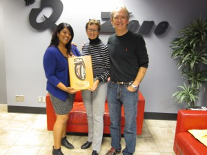 John Shields and Tindy Bassi of Q 100.3 and the Zone@91.3 accept their 2014 Sponsor Plaque from Charlotte Gann