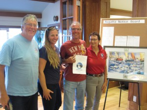 Crew of White Noise, including Marri Todd, gladly receive the free entry gift certificate for Swiftsure 2015 from Charlotte Gann.
